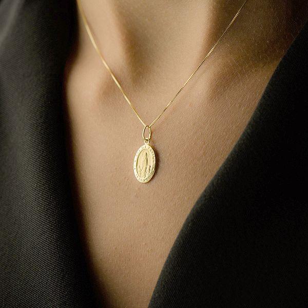 Pingente de Ouro 18k Medalha de Nossa Senhora de Fátima pi15839 - Joiasgold  R  332,64 à vista. Adicionar à sacola 5dc04cb400