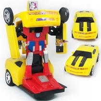 Carrinho Camaro Amarelo Transformers Vira Robô Luz Som Bate Volta - Teck hobby