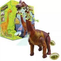 Dinossauro Eletrônico Bota Ovos Brinquedo Anda Emite Luz Som - TOYS