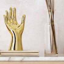 Escultura mão dourada - Id