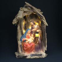 Presépio sagrada familia no tronco com luz - Armazem