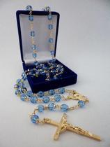 Terço cristal tcheco jablonex azul claro 7mm - folh. ouro - Armazem