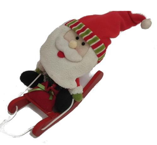Imagem de Boneco Papai Noel no trenó de pelúcia