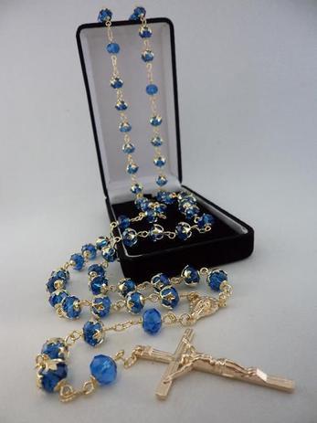 Imagem de Terço cristal aust. azul escuro 8x6mm esp. - folh. ouro