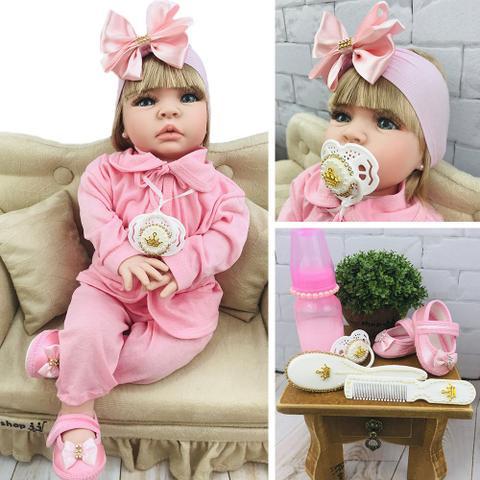 Imagem de Boneca Bebê Reborn Loira Com Cílios Roupa Rosa 16 itens