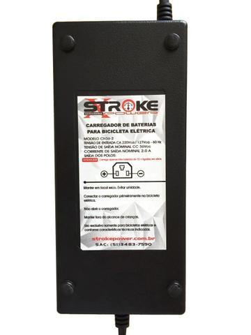 Imagem de Carregador Bateria Bike Eletrica 36v 2ah 6dzm Scooter Alarme