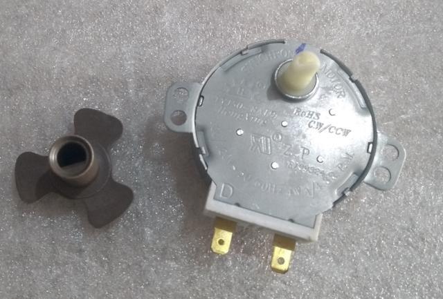 Imagem de motor prato microondas 127v com eixo trevo electrolux mef41